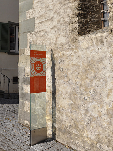 destination glass sign in front of the st. peter and paul church of reichenau - brian switzer, envision+